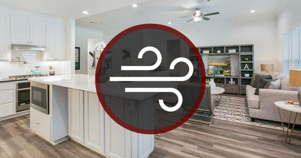 Kitchen and living room with an air quality logo in the foreground