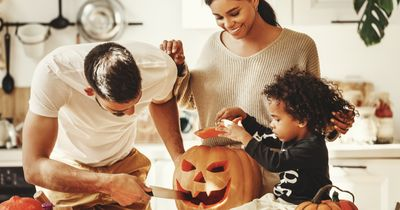 A family carving pumpkins for Halloween.