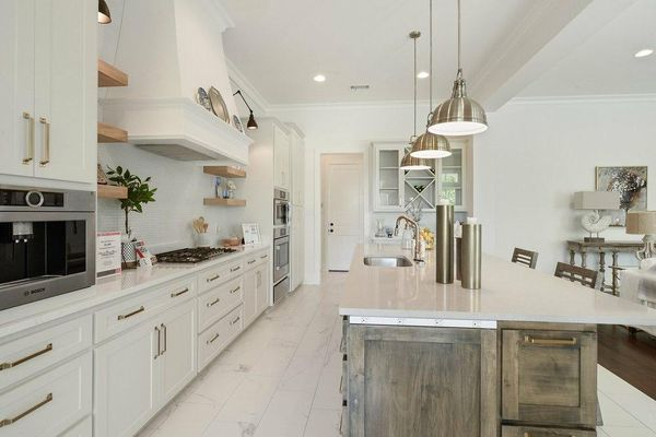 High-end white kitchen by Alvarez Construction Company, LLC