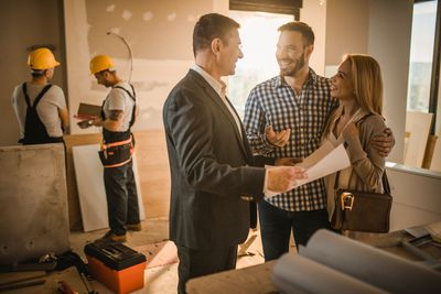 Homebuyers meeting with the builder