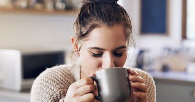 girl sipping a cup of coffee
