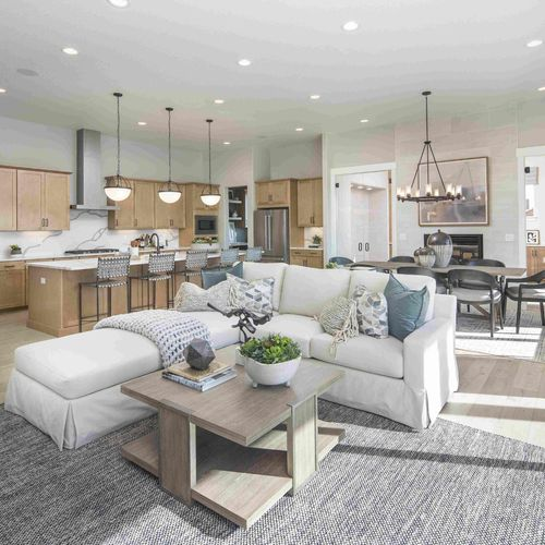 Plan C652 Living/Kitchen/Dining Photo by American Legend Homes
