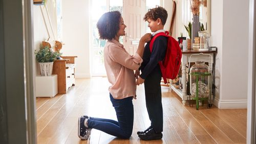 image of son and mother getting ready for school