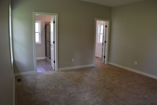 Master Suite with doors to full bath and large closet