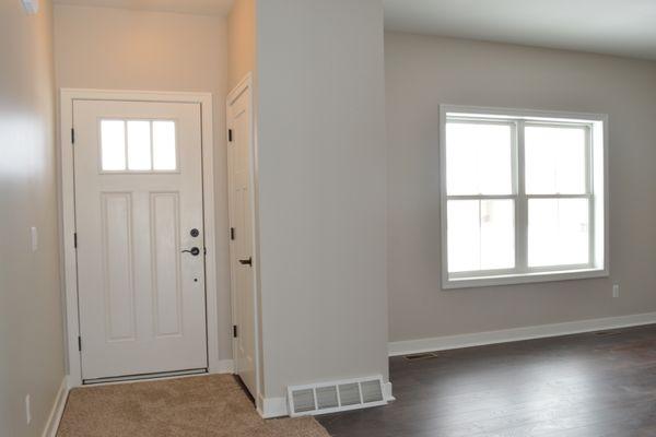 Front Door w/ Coat Closet / Living Room