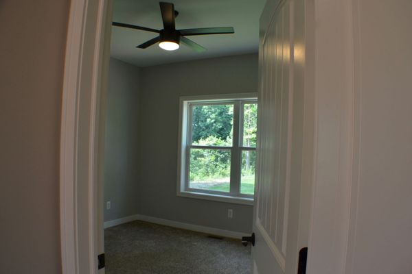 Back bedroom, remote controlled ceiling fan