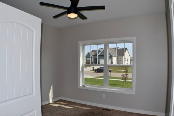 Front bedroom, remote controlled ceiling fan