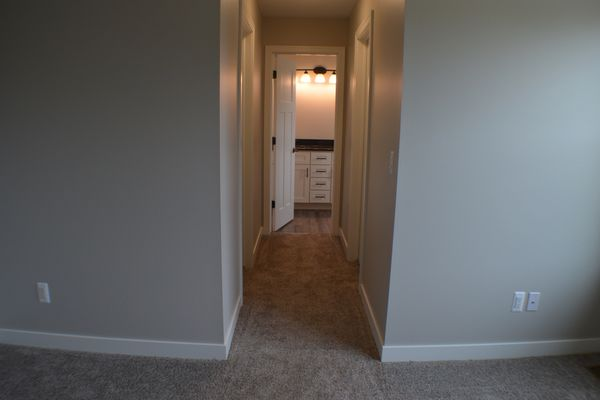 Master bedroom hall to 2 walk-in closets and full bath