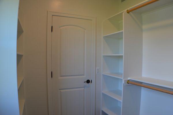Master suite walk in closet with built in storage