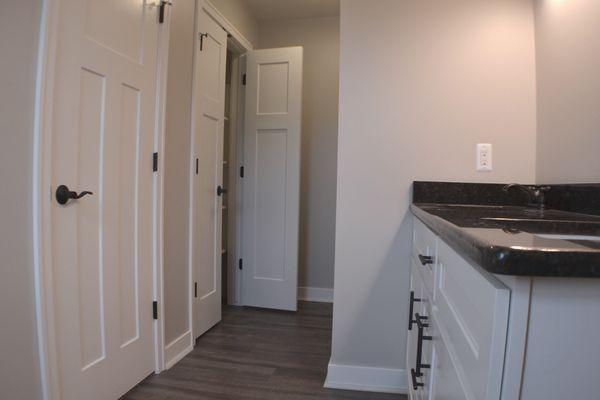 Master bath with floor to ceiling linen storage closet