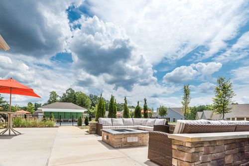 Barley Woods Clubhouse outdoor seating patio umbrellas fire pit