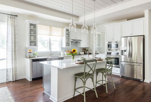 Gormet Kitchen hardwood floors white cabinets natural light