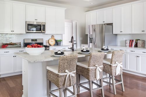 model home kitchen white cabinets hardwood paired home