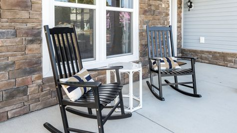 front porch model home rocking chairs