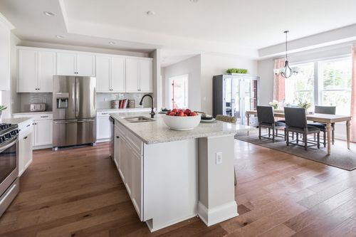 model home large kitchen island hardwood floors
