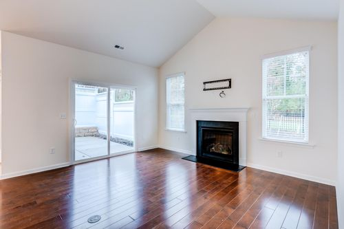 Great room fire place hardwood floors looking out to private courtyard