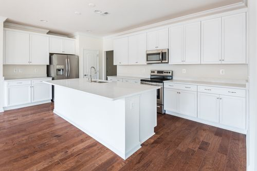 The Amelia Kitchen Island stainless steel appliances hardwood floors Cornerstone Homes