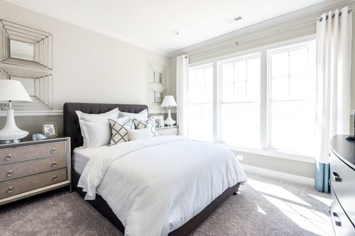 Model Home guest bedroom natural light cornerstone homes