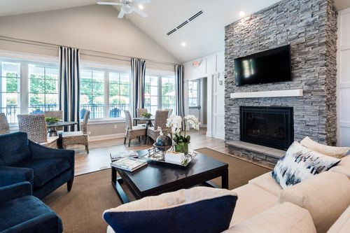 Ashlake Clubhouse interior great room seating fireplace lighting 55+ living Cornerstone Homes