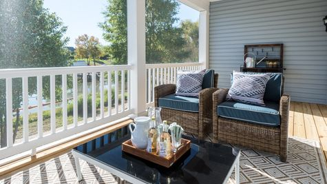 seating screened in porch over looking lake