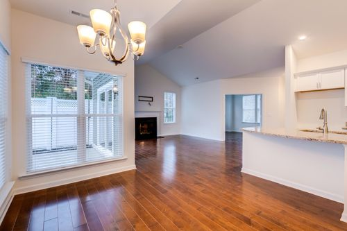 Great Room and kitchen colonnade hardwood floors fire place