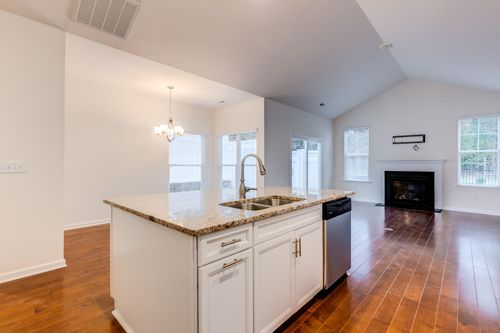 The Colonnade Kitchen island and great room fire place cornerstone homes