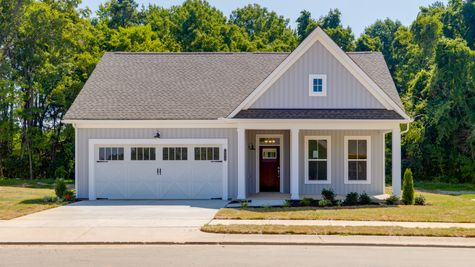 Exterior of gray farm style home by Cornerstone Homes
