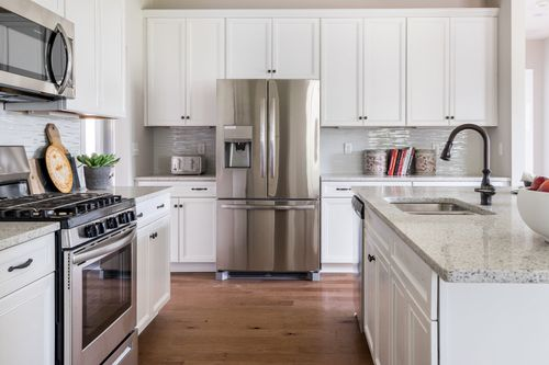 model home kitchen stainless steal appliances