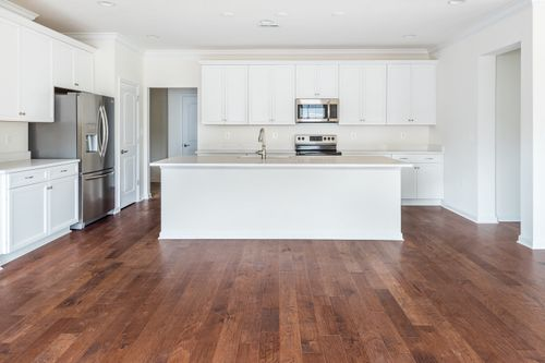 The Amelia Kitchen White Cabinets Hardwood Floor kitchen island Cornerstone Homes