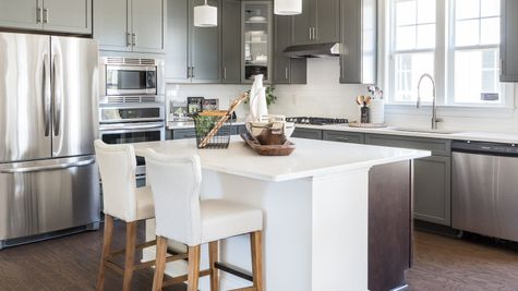 Gray kitchen with stainless appliances by Cornerstone Homes