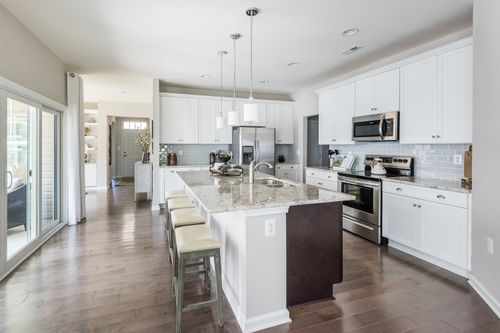 The Caroline Kitchen White Cabinets Backsplash Lighting Cornerstone Homes