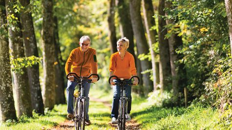Active Adults biking on trail