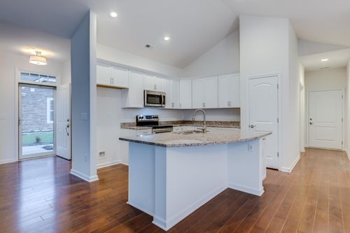 The Colonnade Kitchen And entry way hardwood Floors open floor plan Cornerstone Homes