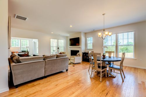 Great room hardwood floors open floor plan seating and dining area
