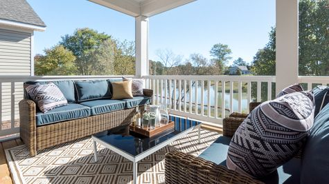 Screen porch overlooking Magnolia Lake by Cornerstone Homes