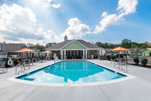 Ashlake Pool and Rear Exterior Clubhouse seating umbrellas resort style amenities