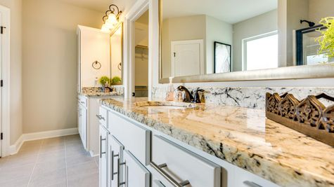 Master Bathroom - granite countertops- bronze Hardware- garden tub- open floor plan- framed mirrors - tile- natural light- DSLD Homes- Lafayette area - Lafayette- Louisiana- The Estates at Moss Bluff