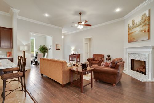 Woodland Manor - Model Home Living Room - DSLD Homes - Reims IV C - Gonzales, LA