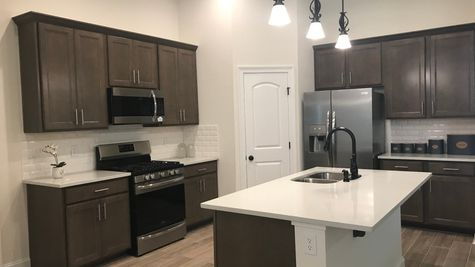 College Heights - Lake Charles- DSLD Homes - Kitchen with painted dark cabinets - stainless steel appliances