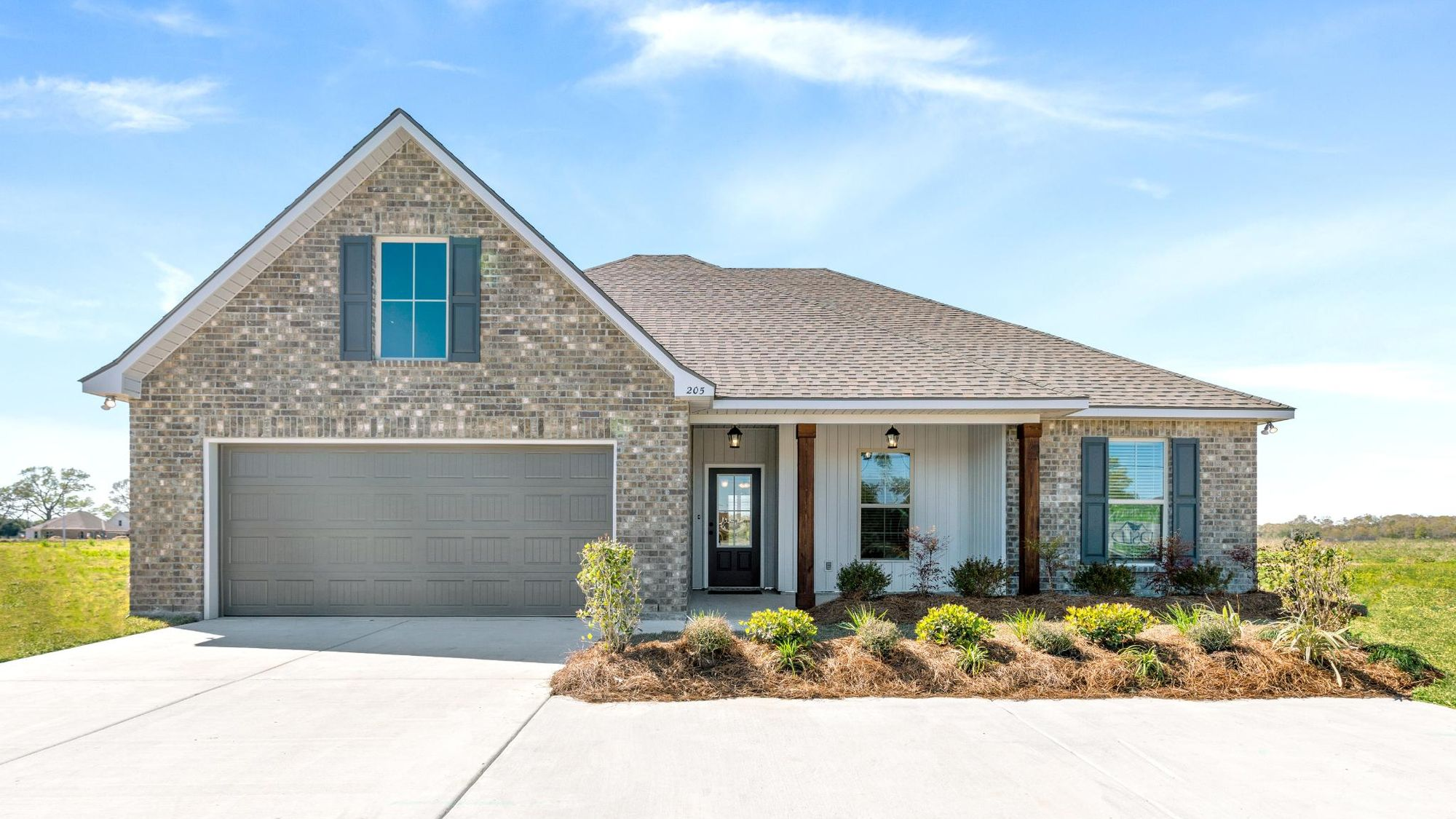 Acadian Meadows Model Home Exterior - DSLD Homes - Lafayette, LA