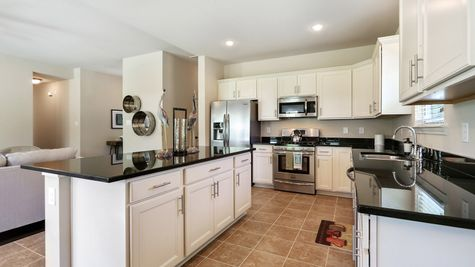 Natural Light- White Cabinets - Dark Granite- Living Room- Kitchen- Open Floor Plan- Model Home- Silver Hill- Community- Ponchatoula Louisiana- Hammond area- DSLD Homes