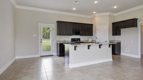 Arbor Walk Kitchen with Espresso Cabinets - DSLD New Construction Homes - Denham Springs, LA