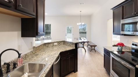 Kitchen in Model Home - DSLD New Construction Homes - Bellawood in Pensacola Florida