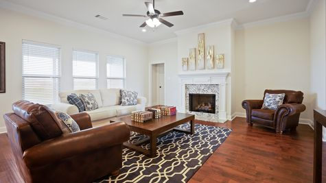 Large Living Room with Fireplace and Decor New Home Construction - DSLD Homes Pelican Crossing Gonzales
