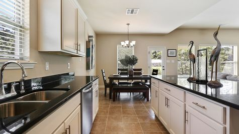 Natural Light- White Cabinets - Dark Granite- dining area- Kitchen- Open Floor Plan- Model Home- Silver Hill- Community- Ponchatoula Louisiana- Hammond area- DSLD Homes