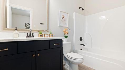 Jamestown Crossing - Domenico II A Plan - Prairieville, LA - DSLD Homes - Model Home Hall Bathroom