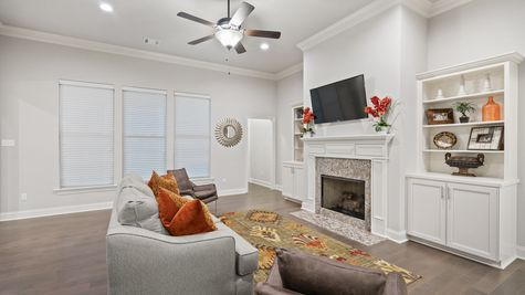 Living Room with Decor and Fireplace - The Settlement at Live Oak - DSLD Homes Thibodaux