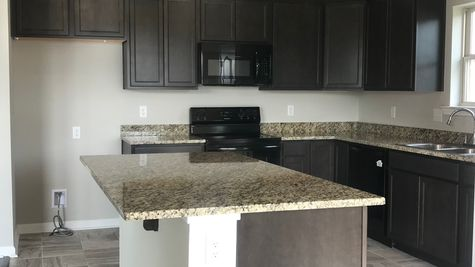RAVENSWOOD IV A  Elevation – Brown Kitchen - BELLE SAVANNE Community - DSLD Homes - SULPHUR, LA