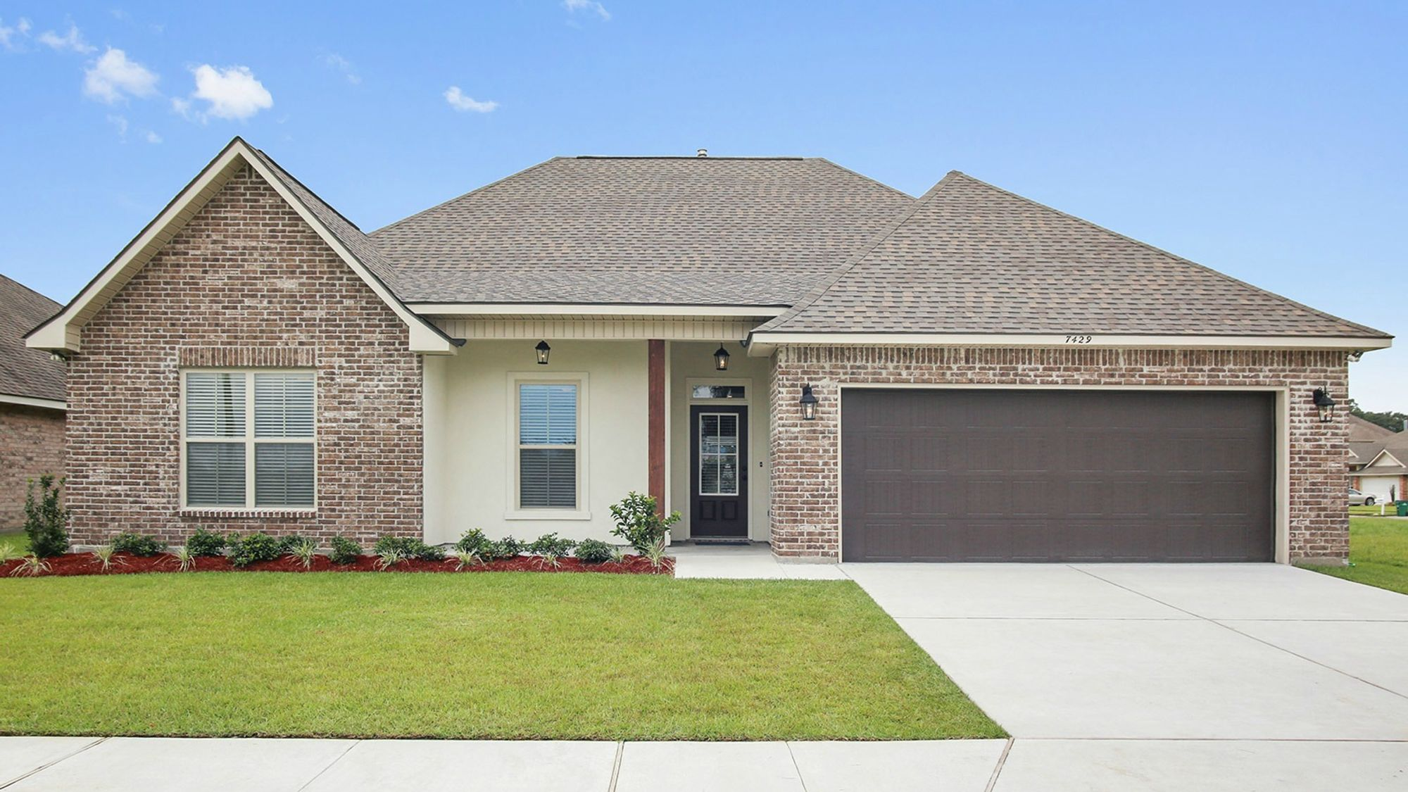 Front view of Model Home -cypress beam- stucco- brick- front loading garage- lanterns- painted door- DSLD Homes- Marrero - Louisiana- New Orleans area- Brentwood