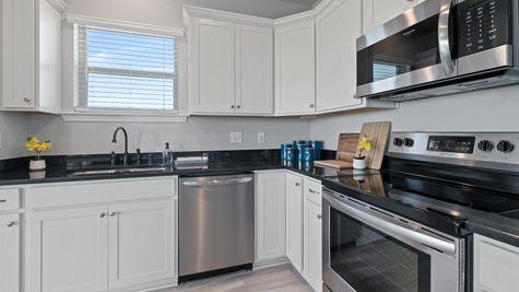 Acadian Meadows Model Home Kitchen - DSLD Homes - Lafayette, LA